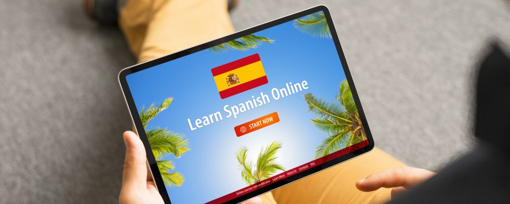 Man taking online courses and learning Spanish language